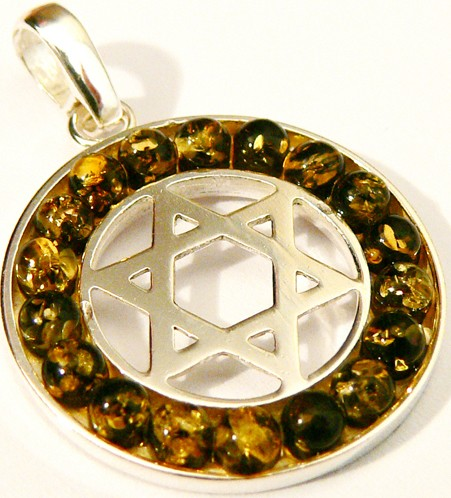 A pendant of sterling silver Jewish star surrounded by green Baltic amber .