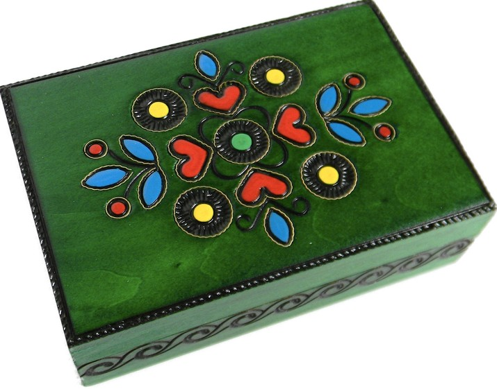 Green wooden box with heart, and flowers and dots.