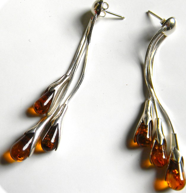 Three strand tear shapped cognac Baltic amber earring