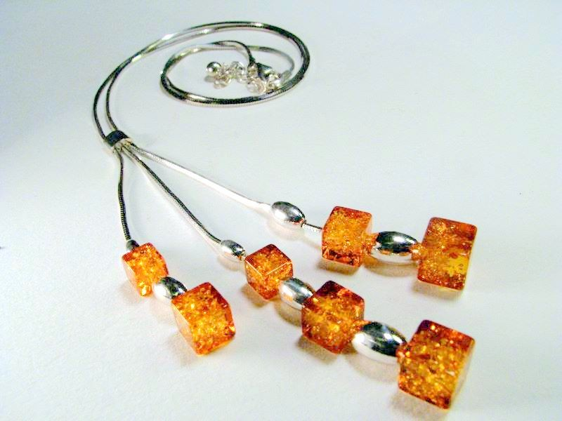 Three pendent Necklace with light honey cubes of Baltic amber