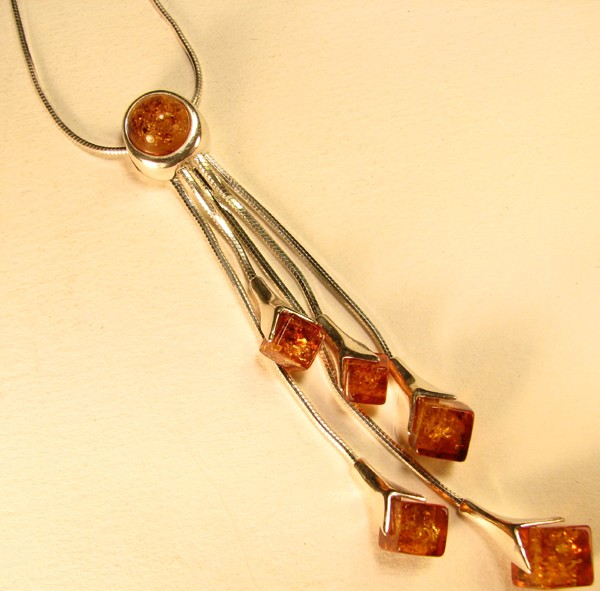 5 strand amber pendant on a silver chain.
