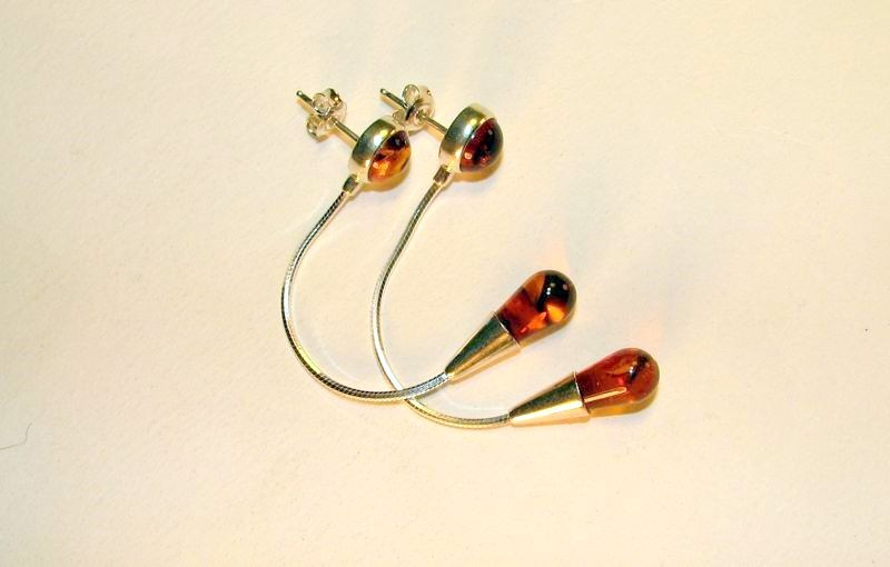 Honey Baltic Amber tear drop earring on sterling silver snake cin