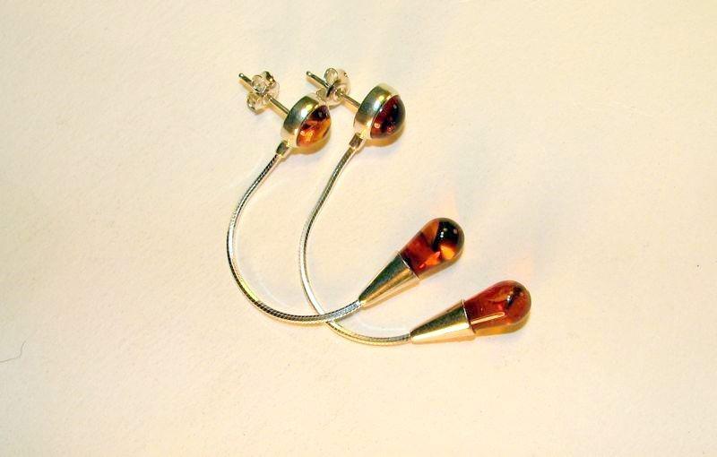 Honey Baltic Amber tear drop earring on sterling silver snake cin