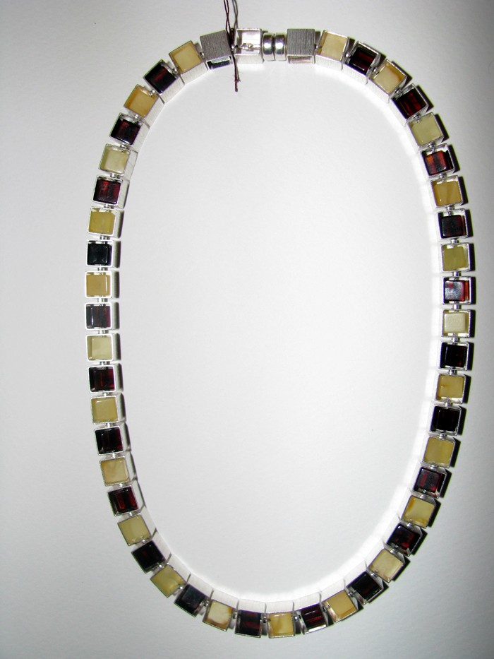 Butterscotch and cherry Baltic amber cube in cube silver housing necklace