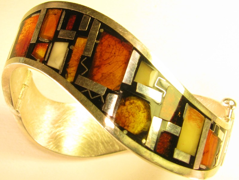 undulating silver bracelet with enamel amber top