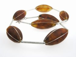Necklace of elongated cognac Baltic beads shaped like dates