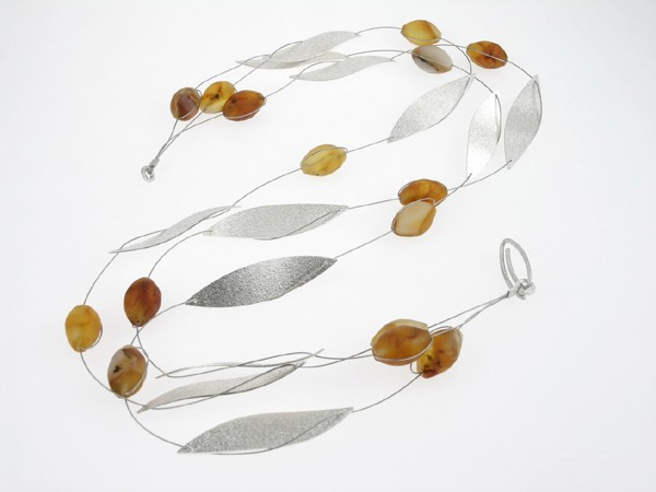 Amber necklace of silver leaves and amber berries.