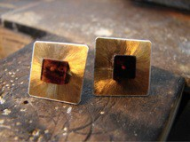 Gold plated square earring with coganc Baltic amber cube in the center