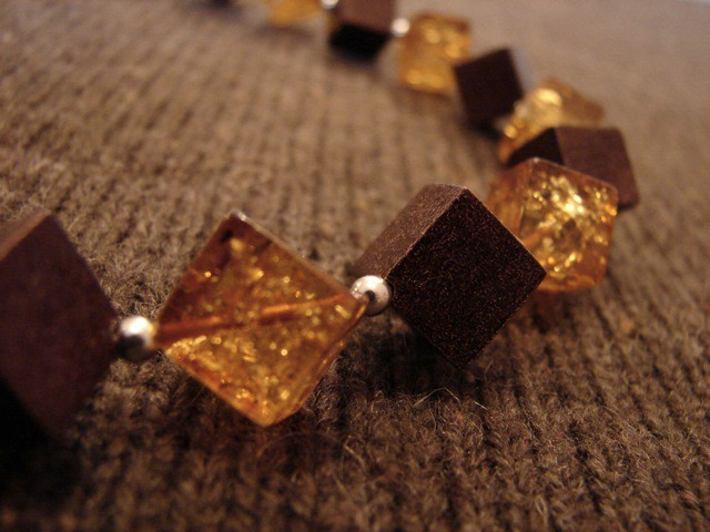 Hone Baltic amber cube and choclate color enamel coated silver cube chocker.