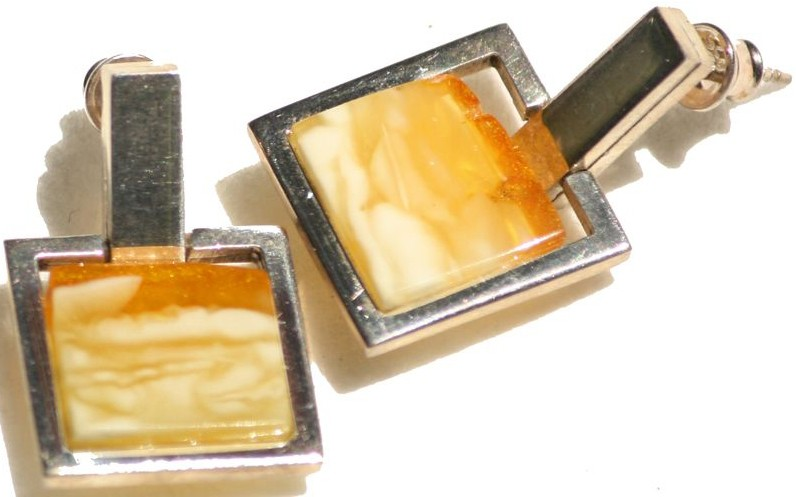 Square butterscotch Baltic amber earrings in a sterlingsilver frame.