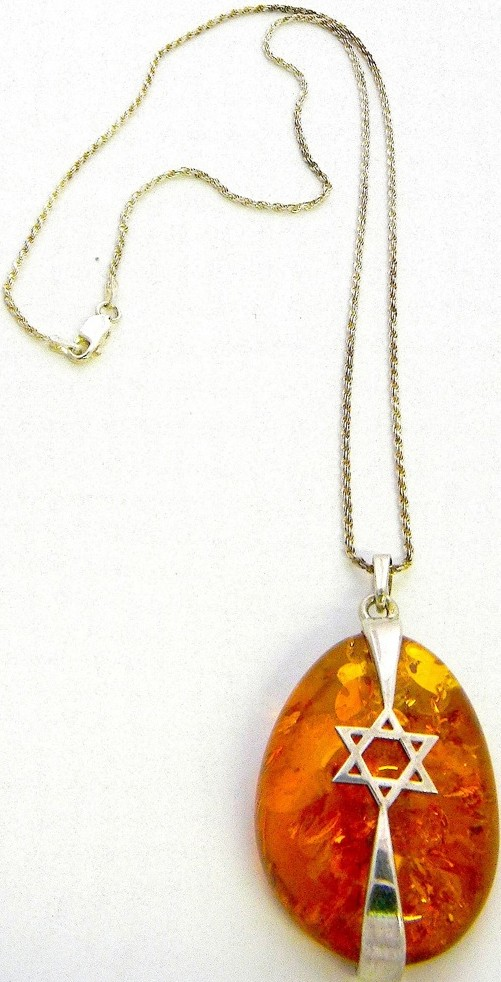 Honey Baltic amber nugget with a silver Jewish star